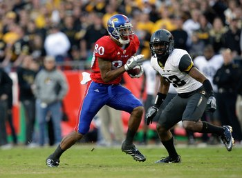 KANSAS CITY, MO - NOVEMBER 28:  Dezmon Briscoe #80 of the Kansas Jayhawks runs with the ball for yardage during their game against the Missouri Tigers during the game at Arrowhead Stadium on November 28, 2009 in Kansas City, Missouri. (Photo by Jamie Squi