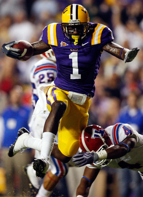 BATON ROUGE, LA - NOVEMBER 14:  Brandon LaFell #1 of the LSU Tigers jumps over Jai Eugene #4 of the Louisiana Tech Bulldogs on his way to scoring a touchdown at Tiger Stadium on November 14, 2009 in Baton Rouge, Louisiana.  (Photo by Chris Graythen/Getty
