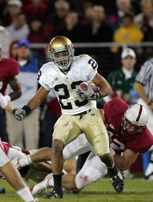 PALO ALTO, CA - NOVEMBER 28:  Golden Tate #23 of the Notre Dame Fighting Irish runs with the ball during their game against the Stanford Cardinal at Stanford Stadium on November 28, 2009 in Palo Alto, California.  (Photo by Ezra Shaw/Getty Images)
