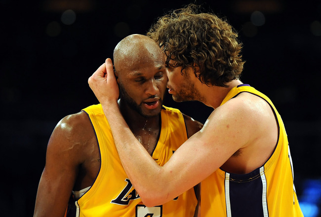 LOS ANGELES, CA - MAY 27:  (L-R) Lamar Odom #7 and Pau Gasol #16 of the Los Angeles Lakers hug in the fourth quarter against the Denver Nuggets in Game Five of the Western Conference Finals during the 2009 NBA Playoffs at Staples Center on May 27, 2009 in