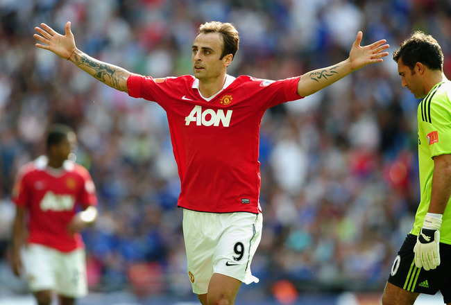 LONDON, ENGLAND - AUGUST 08:  Henrique Hilario of Chelsea (R) looks dejected as Dimitar Berbatov of Manchester United celebrates as he scores their third goal during the FA Community Shield match between Chelsea and Manchester United at Wembley Stadium on
