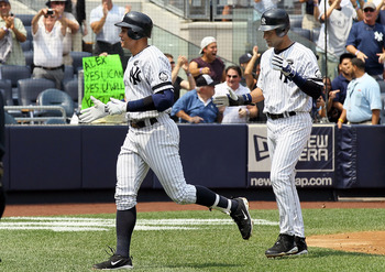 NEW YORK - AUGUST 04:  Alex Rodriguez #13 of the New York Yankees celebrates his 600th career home run in the first inning against the Toronto Blue Jays with teammate Derek Jeter #2 on August 4, 2010 at Yankee Stadium in the Bronx borough of New York City