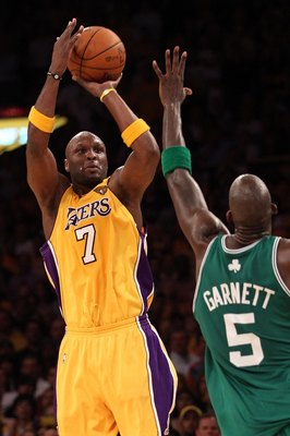 LOS ANGELES, CA - JUNE 17:  Lamar Odom #7 of the Los Angeles Lakers shoots over Kevin Garnett #5 of the Boston Celtics in Game Seven of the 2010 NBA Finals at Staples Center on June 17, 2010 in Los Angeles, California.  NOTE TO USER: User expressly acknow