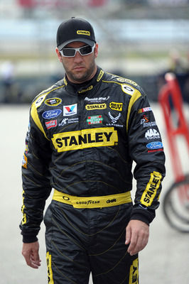 LOUDON, NH - JUNE 26: Elliott Sadler, driver of the #19 Stanley Ford, walks to the garage during practice for the NASCAR Sprint Cup Series LENOX Industrial Tools 301 at New Hampshire Motor Speedway on June 26, 2010 in Loudon, New Hampshire.  (Photo by Dre
