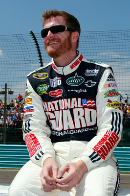 WATKINS GLEN, NY - AUGUST 08:  Dale Earnhardt Jr., driver of the #88 AMP Energy/National Guard Chevrolet, stands on the grid prior to the NASCAR Sprint Cup Series Heluva Good! Sour Cream Dips at Watkins Glen International on August 8, 2010 in Watkins Glen
