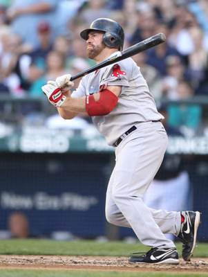 SEATTLE - JULY 23: Kevin Youkilis #20 of the Boston Red Sox singles in the fourth inning against the Seattle Mariners at Safeco Field on July 23, 2010 in Seattle, Washington. (Photo by Otto Greule Jr/Getty Images)