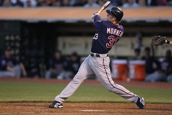 OAKLAND, CA - JUNE 04:  Justin Morneau #33 of the Minnesota Twins bats against the Oakland Athletics during an MLB game at the Oakland-Alameda County Coliseum on June 4, 2010 in Oakland, California.  (Photo by Jed Jacobsohn/Getty Images)