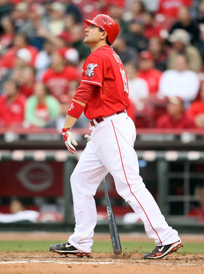 CINCINNATI - MAY 18:  Joey Votto #19 of the Cincinnati Reds watches his home run leave the park in the 8th inning during the game against the Milwaukee Brewers at Great American Ball Park on May 18, 2010 in Cincinnati, Ohio. The Reds won 5-4.  (Photo by A