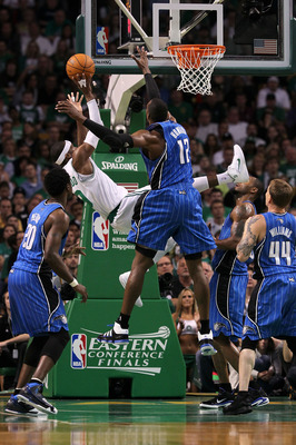 BOSTON - MAY 28:  Rajon Rondo #9 of the Boston Celtics attempts a shot as he falls and was fouled against Dwight Howard #12 of the Orlando Magic in Game Six of the Eastern Conference Finals during the 2010 NBA Playoffs at TD Garden on May 28, 2010 in Bost