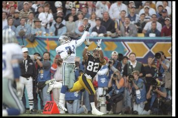28 Jan 1996:  Defensive back Deion Sanders of the Dallas Cowboys (left) breaks up a pass intended for Pittsburgh Steelers wide receiver Yancey Thigpen during Super Bowl XXX at Sun Devil Stadium in Tempe, Arizona.  The Cowboys won the game, 27-17. Mandator