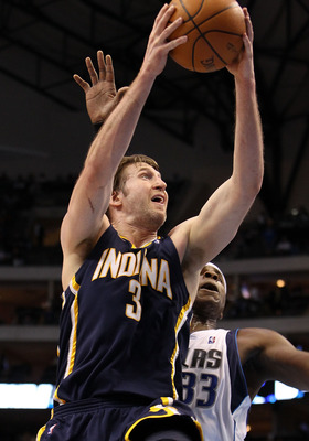 DALLAS - FEBRUARY 22:  Forward Troy Murphy #3 of the Indiana Pacers takes a shot against Brendan Haywood #33 of the Dallas Mavericks on February 22, 2010 at American Airlines Center in Dallas, Texas.  NOTE TO USER: User expressly acknowledges and agrees t