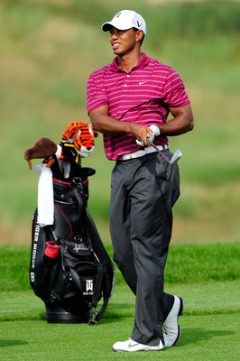 KOHLER, WI - AUGUST 10:  Tiger Woods watches his shot during a practice round prior to the start of the 92nd PGA Championship on the Straits Course at Whistling Straits on August 10, 2010 in Kohler, Wisconsin.  (Photo by Stuart Franklin/Getty Images)