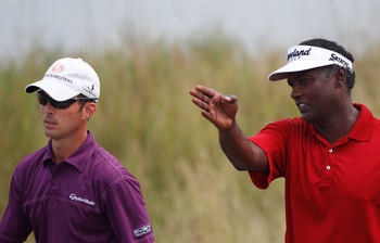 KOHLER, WI - AUGUST 10:  Vijay Singh of Fiji (R) talks with Mike Weir of Canada (L) during a practice round prior to the start of the 92nd PGA Championship on the Straits Course at Whistling Straits on August 10, 2010 in Kohler, Wisconsin.  (Photo by Chri