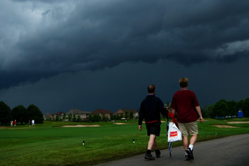 OAKVILLE, ONTARIO - JULY 26:  Spectators leave the golf course after play was cancelled for the day due to an extreme thunderstorm during round three of the RBC Canadian Open at Glen Abbey Golf Club on July 26, 2009 in Oakville, Ontario, Canada.  (Photo b