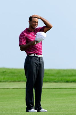 KOHLER, WI - AUGUST 10:  Tiger Woods looks on during a practice round prior to the start of the 92nd PGA Championship on the Straits Course at Whistling Straits on August 10, 2010 in Kohler, Wisconsin.  (Photo by Stuart Franklin/Getty Images)