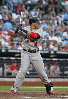 NEW YORK - JULY 27:  Yadier Molina #4 of the St. Louis Cardinals in action against the New York Mets during their game on July 27, 2010 at Citi Field in the Flushing neighborhood of the Queens borough of New York City.  (Photo by Al Bello/Getty Images)