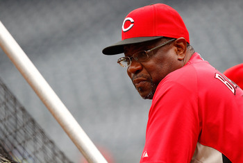 PITTSBURGH - AUGUST 03:  Manager Dusty Baker #12 of the Cincinnati Reds watches batting practice prior to the game against the Pittsburgh Pirates on August 3, 2010 at PNC Park in Pittsburgh, Pennsylvania.  (Photo by Jared Wickerham/Getty Images)