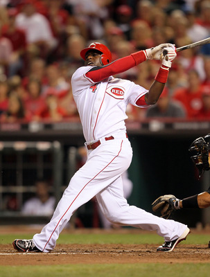 CINCINNATI - JULY 17:  Brandon Phillips #4 of the Cincinnati Reds swings at a pitch during the game against the Colorado Rockies at Great American Ball Park on July 17, 2010 in Cincinnati, Ohio.  (Photo by Andy Lyons/Getty Images)