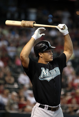 PHOENIX - JULY 11:  Mike Stanton #27 of the Florida Marlins warms up on deck during the Major League Baseball game against the Arizona Diamondbacks at Chase Field on July 11, 2010 in Phoenix, Arizona.  The Marlins defeated the Diamondbacks 2-0.  (Photo by