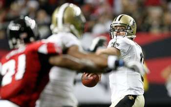 ATLANTA - DECEMBER 13:  Quarterback Drew Brees #9 of the New Orleans Saints against the Atlanta Falcons at Georgia Dome on December 13, 2009 in Atlanta, Georgia.  (Photo by Kevin C. Cox/Getty Images)