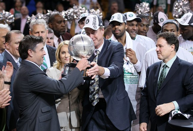 BOSTON - MAY 28:  Team owner Wyc Grousbeck of the Boston Celtics receives the Eastern Conference trophy from Dave Cowens after the Celtics won 96-84 against the Orlando Magic in Game Six of the Eastern Conference Finals during the 2010 NBA Playoffs at TD
