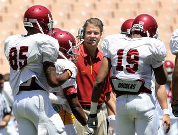LOS ANGELES, CA - MAY 01:  Head coach Lane Kiffin gives instructions in the offensive huddle during the  USC Trojans spring game on  May 1, 2010 at the Los Angeles Memorial Coliseum in Los Angeles, California.  (Photo by Stephen Dunn/Getty Images)