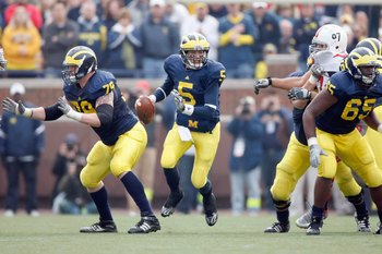ANN ARBOR, MI - NOVEMBER 21:  Quarterback Tate Forcier #5 of the Michigan Wolverines moves to pass the ball during the game against the Ohio State Buckeyes on November 21, 2009 at Michigan Stadium in Ann Arbor, Michigan. Ohio State won the game 21-10. (Ph