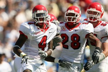 PASADENA, CA - SEPTEMBER 27:  Damion Owens #4, A.J. Jefferson #28 and Ben Jacobs #54 of the Frenso State Bulldogs celebrates a defensive play against the UCLA Bruins during the game on September 27, 2008 at the Rose Bowl in Pasadena, California.  (Photo b