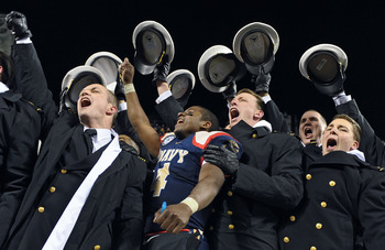 PHILADELPHIA - DECEMBER 12: Quarterback Ricky Dobbs #4 of the Navy Midshipmen, and game MVP, celebrates their 17-3 victory over the Army Black Knights on December 12, 2009 at Lincoln Financial Field in Philadelphia, Pennsylvania. (Photo by Drew Hallowell/