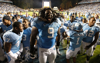 CHAPEL HILL, NC - NOVEMBER 07:  Marvin Austin #9 of the North Carolina Tar Heels celebrates with teammates after a 19-6 victory over the Duke Blue Devils during their game at Kenan Stadium on November 7, 2009 in Chapel Hill, North Carolina.  (Photo by Str