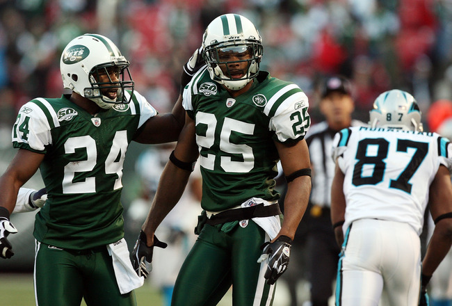 EAST RUTHERFORD, NJ - NOVEMBER 29:  Kerry Rhodes #25 of the New York Jets celebrates his second interception of the game against the Carolina Panthers with teammate Darrelle Revis #24 on November 29, 2009 at Giants Stadium in East Rutherford, New Jersey.