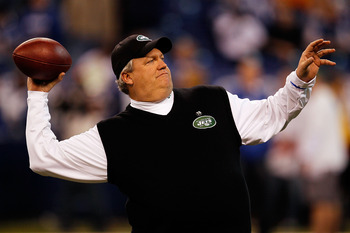 INDIANAPOLIS - JANUARY 24:  Rex Ryan, head coach of the New York Jets, throws a pass during warm-ups before playing against the Indianapolis Colts during the AFC Championship Game at Lucas Oil Stadium on January 24, 2010 in Indianapolis, Indiana.  (Photo
