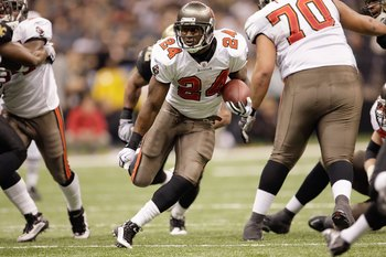 NEW ORLEANS - DECEMBER 27:  Carnell Williams #24 of the Tampa Bay Buccaneers runs the ball up the middle during the game against the New Orleans Saints at the Louisiana Superdome on December 27, 2009 in New Orleans, Louisiana. (Photo by Jamie Squire/Getty