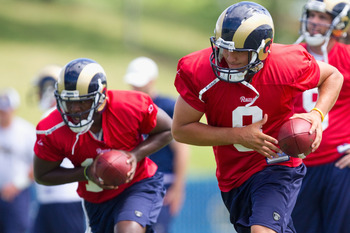 EARTH CITY, MO - JULY 31: Sam Bradford #8 of the St. Louis Rams participates in quarterback drills during training camp at the Russell Athletic Training Facility on July 31, 2010 in Earth City, Missouri.  (Photo by Dilip Vishwanat/Getty Images)