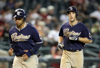 PHOENIX - AUGUST 08:  Chris Denorfia #13 (R) of the San Diego Padres rounds the bases after hitting a 2 run home run against the Arizona Diamondbacks during the eighth inning of the Major League Baseball game at Chase Field on August 8, 2010 in Phoenix, A