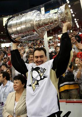 Miroslav Satan holds the Stanley Cup.