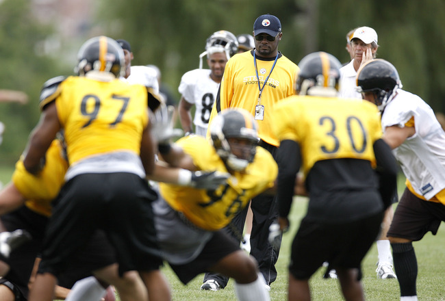 LATROBE, PA - AUGUST 06:  Head coach Mike Tomlin of the Pittsburgh Steelers looks on during training camp at St. Vincent College on August 6, 2009 in Latrobe, Pennsylvania.  (Photo by Gregory Shamus/Getty Images)