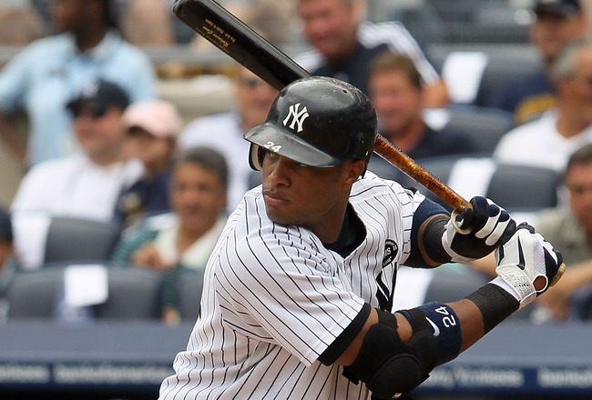 NEW YORK - AUGUST 04:  Robinson Cano #24 of the New York Yankees bats against the Toronto Blue Jays on August 4, 2010 at Yankee Stadium in the Bronx borough of New York City.  (Photo by Jim McIsaac/Getty Images)