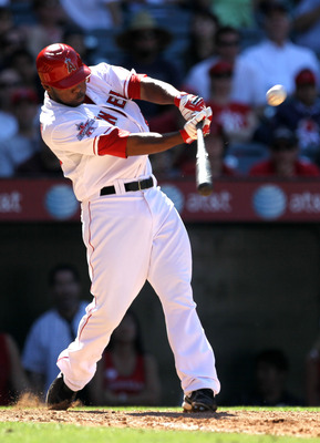 ANAHEIM, CA - MAY 30:  Howie Kendrick #47 of the Los Angeles Angels of Anaheim hits a three run walk off home run in the ninth inning against the Seattle Mariners on May 30, 2010 at Angel Stadium in Anaheim, California.  The Angels won 9-7.  (Photo by Ste