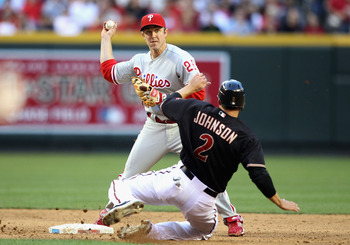 PHOENIX - APRIL 24:  Infielder Chase Utley #26 of the Philadelphia Phillies throws over the sliding Kelly Johnson #2 of the Arizona Diamondbacks attempting a double play during the third inning of the Major League Baseball game at Chase Field on April 24,