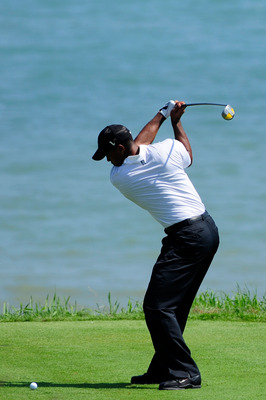KOHLER, WI - AUGUST 12:  Tiger Woods hits his tee shot on the 18th hole during the first round of the 92nd PGA Championship on the Straits Course at Whistling Straits on August 12, 2010 in Kohler, Wisconsin.  (Photo by Stuart Franklin/Getty Images)