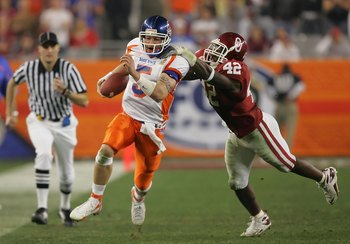 GLENDALE, AZ - JANUARY 01:  Quarterback Jared Zabransky #5 of the Boise State Broncos is grabbed by the back of the jersey by linebacker Rufus Alexander #42 of the Oklahoma Sooners in the second quarter at the Tostito's Fiesta Bowl at University of Phoeni