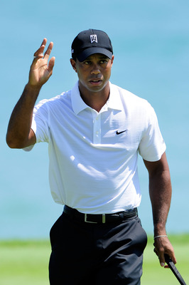 KOHLER, WI - AUGUST 12:  Tiger Woods celebrates making birdie on the 13th hole during the first round of the 92nd PGA Championship on the Straits Course at Whistling Straits on August 12, 2010 in Kohler, Wisconsin.  (Photo by Stuart Franklin/Getty Images)