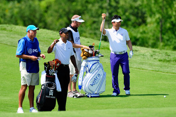 KOHLER, WI - AUGUST 12:  Tiger Woods (L) and Y.E. Yang of South Korea pull clubs on the 11th hole during the first round of the 92nd PGA Championship on the Straits Course at Whistling Straits on August 12, 2010 in Kohler, Wisconsin.  (Photo by Stuart Fra