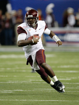 ATLANTA - DECEMBER 31:  Quarterback Tyrod Taylor #5 of the Virginia Tech Hokies runs with the ball during the Chick-Fil-A Bowl against the Tennessee Volunteers at the Georgia Dome on December 31, 2009 in Atlanta, Georgia.  The Hokies beat the Volunteers 3