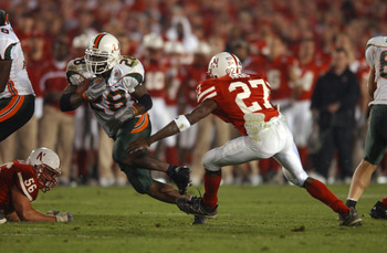 3 Jan 2002:  Clinton Portis #28 of Miami carries the football against the defense of Willie Amos #27 of Nebraska during the Rose Bowl National Championship game at the Rose Bowl in Pasadena, California.  Miami won the game 37-14, winning the BCS and the N