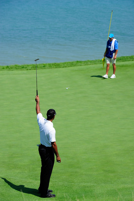 KOHLER, WI - AUGUST 12:  Tiger Woods urges a putt to drop on the 17th green as his caddie Steve Williams looks on during the first round of the 92nd PGA Championship on the Straits Course at Whistling Straits on August 12, 2010 in Kohler, Wisconsin.  (Pho