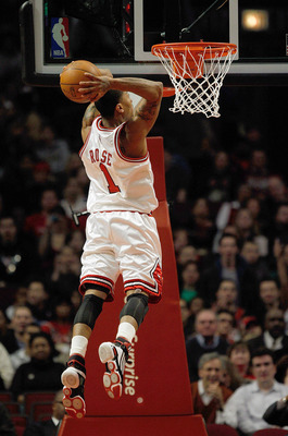 CHICAGO - MARCH 09: Derrick Rose #1 of the Chicago Bulls goes up for a dunk against the Utah Jazz at the United Center on March 9, 2010 in Chicago, Illinois. NOTE TO USER: User expressly acknowledges and agrees that, by downloading and/or using this Photo