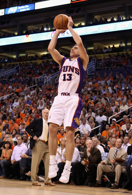 PHOENIX - MAY 03:  Steve Nash #13 of the Phoenix Suns puts up a shot against the San Antonio Spurs during Game One of the Western Conference Semifinals of the 2010 NBA Playoffs at US Airways Center on May 3, 2010 in Phoenix, Arizona. The Suns defeated the