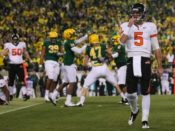 EUGENE,OR - DECEMBER 03: Quarterback Sean Canfield #47 of the Oregon State Beavers walks off the field after teammate Jacquizz Rodgers #1 is tackled by Kiko Alonso #47 of the Oregon Ducks during the second quarter of the game at Autzen Stadium on December